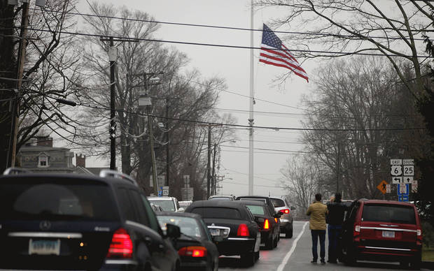 A funeral procession follows the hearse carrying the casket of Sandy Hook Elementary School shooting victim, Jack Pinto, 6, Monday, Dec. 17, 2012, in Newtown, Conn. Pinto was killed when a gunman walked into Sandy Hook Elementary School in Newtown Friday and opened fire, killing 26 people, including 20 children.(AP Photo/David Goldman) ORG XMIT: CTDG115