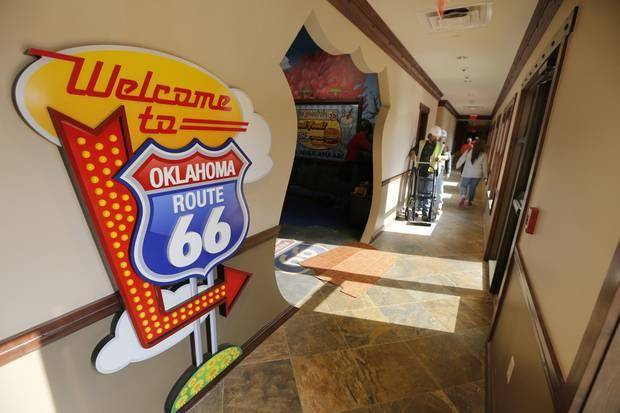 The entrance to the indoor playroom of the Toby Keith Foundation's OK Kids Korral reflects the room's Route 66 theme. Photo By Steve Gooch, The Oklahoman