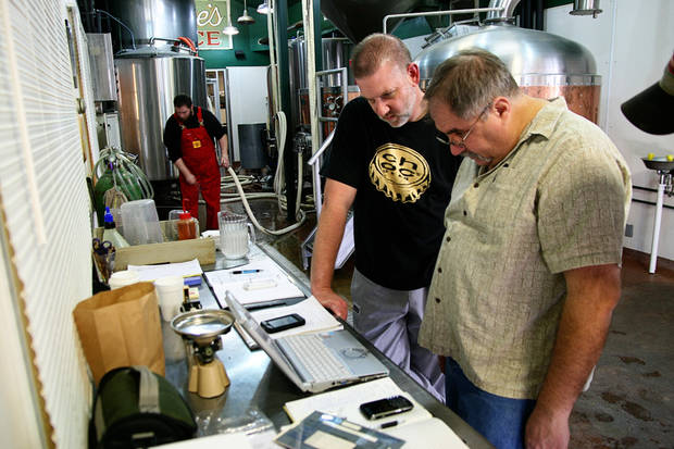 William Scott, right, and Choc Beer Co. Brewmaster Michael Lalli consult a computer containing plans for the Gratzer beer they brewed recently. Brewer B.J. Howell is also pictured. PHOTO BY NICK TROUGAKOS, THE OKLAHOMAN <strong>unknown</strong>