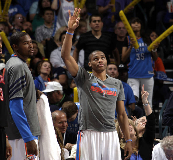 Oklahoma City's Russell Westbrook (0) celebrates a Thunder three-point shot during the NBA basketball game between the Oklahoma City Thunder and the Toronto Raptors at Chesapeake Energy Arena in Oklahoma City, Sunday, April 8, 2012. Photo by Sarah Phipps, The Oklahoman.