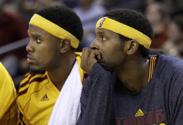 Cleveland Cavaliers shooting guard Daniel Gibson, left, and small forward C.J. Miles sit on the bench during the fourth quarter of an NBA basketball game against the Golden State Warriors in Oakland, Calif., Wednesday, Nov. 7, 2012. The Warriors won 106-96. (AP Photo/Jeff Chiu)