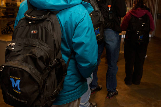 Students stand in line for lunch at the South Dakota School of Mines and Technology, on Feb. 15, 2013. About 50 students and four faculty members at the school are enrolled in a pilot program at the school that uses Biocryptology -- or one's fingerprint and hemoglobin -- in place of cash or credit cards. School officials say the program has so far been successful and he hopes to spread it campus-wide soon. (AP Photo, Amber Hunt)