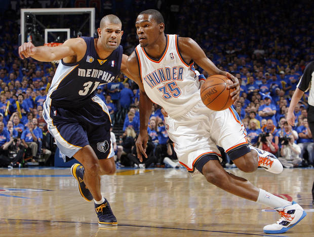 Oklahoma City's Kevin Durant (35) drives the ball past Shane Battier (31) of Memphis in the first half during game 7 of the NBA basketball Western Conference semifinals between the Memphis Grizzlies and the Oklahoma City Thunder at the OKC Arena in Oklahoma City, Sunday, May 15, 2011. Photo by Nate Billings, The Oklahoman