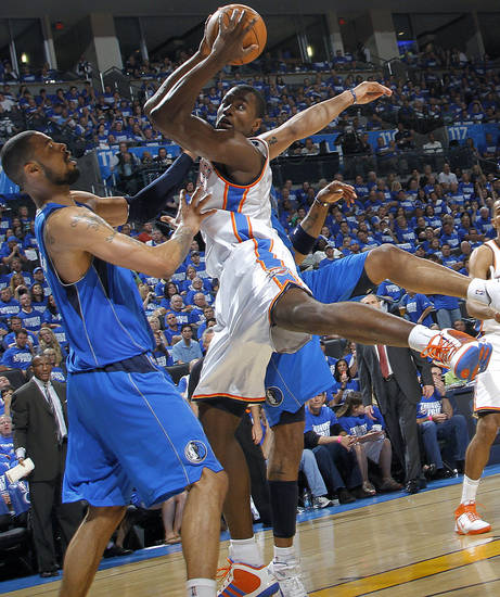 Tyson Chandler (6) of Dallas fouls Oklahoma City's Serge Ibaka (9) during game 3 of the Western Conference Finals of the NBA basketball playoffs between the Dallas Mavericks and the Oklahoma City Thunder at the OKC Arena in downtown Oklahoma City, Saturday, May 21, 2011. Photo by Chris Landsberger, The Oklahoman