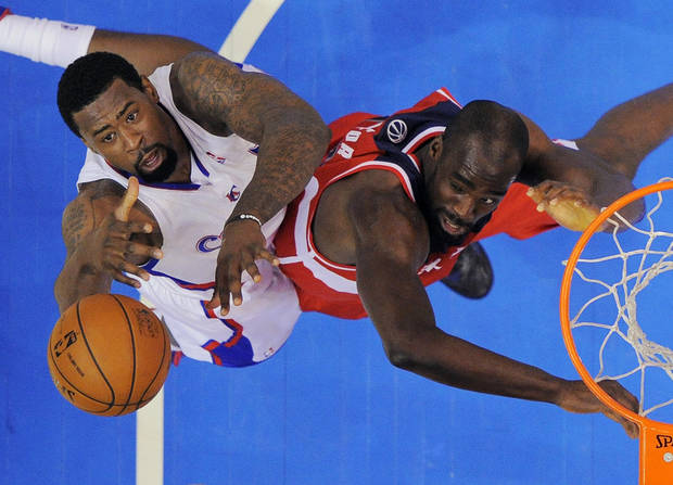 Los Angeles Clippers center DeAndre Jordan, left, reaches for a rebound against Washington Wizards center Emeka Okafor during the first half of their NBA basketball game, Saturday, Jan. 19, 2013, in Los Angeles.  (AP Photo/Mark J. Terrill)