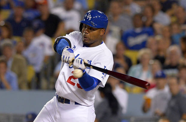 Los Angeles Dodgers' Carl Crawford hits an RBI ground rule double during the fourth inning of their baseball game against the Chicago Cubs, Monday, Aug. 26, 2013, in Los Angeles.  (AP Photo/Mark J. Terrill)