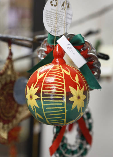 Christmas decorations for sale at the PAMBE Ghana Global Market in Oklahoma City. <strong>Steve Gooch - The Oklahoman</strong>