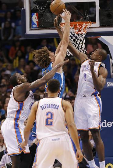 Oklahoma City Thunder's Kendrick Perkins (5) and Serge Ibaka (9) defend on New Orleans Hornets' Robin Lopez (15) during the NBA basketball game between the Oklahoma City Thunder and the New Orleans Hornets at the Chesapeake Energy Arena on Wednesday, Feb. 27, 2013, in Oklahoma City, Okla. Photo by Chris Landsberger, The Oklahoman