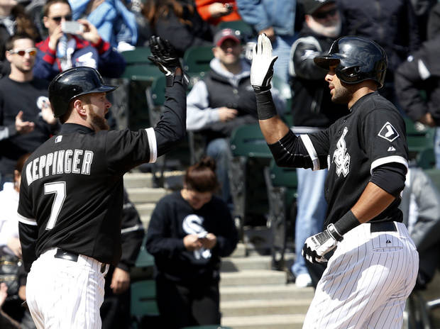 Chicago White Sox's Jeff Keppinger (7) greets Alex Rios at home after the pair scored on Rios' home run off Cleveland Indians starting pitcher Zach McAllister during the fifth inning of a baseball game Wednesday, April 24, 2013, in Chicago. (AP Photo/Charles Rex Arbogast)