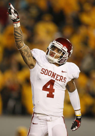 Oklahoma's Kenny Stills (4) celebrates his first touchdown catch of the fourth quarter during a college football game between the University of Oklahoma and West Virginia University on Mountaineer Field at Milan Puskar Stadium in Morgantown, W. Va., Nov. 17, 2012. OU won, 50-49. Photo by Nate Billings, The Oklahoman