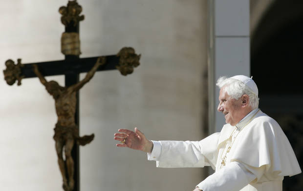 Pope Benedict XVI greets the faithful at the end of his the weekly general audience at the Vatican, Wednesday, Oct. 22, 2008. (AP Photo/Gregorio Borgia) ORG XMIT: ROM103