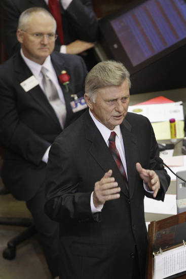 Arkansas Gov. Mike Beebe, right, gestures as he delivers his State of the State address as House parliamentarian Buddy Johnson listens in the House chamber at the Arkansas state Capitol in Little Rock, Ark., Tuesday, Jan. 15, 2013. (AP Photo/Danny Johnston)