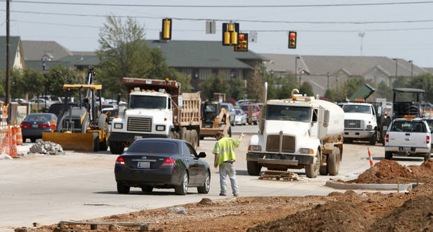 Construction continues at Covell and Kelly in Edmond.  Photo By Steve Gooch, The Oklahoman