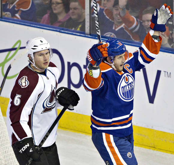 Colorado Avalanche&#039;s Erik Johnson (6) stands by as Edmonton Oilers&#039; Shawn Horcoff celebrates his goal during the second period of their NHL hockey game, Monday, Jan. 28, 2013, in Edmonton, Alberta. (AP Photo/The Canadian Press, Jason Franson)