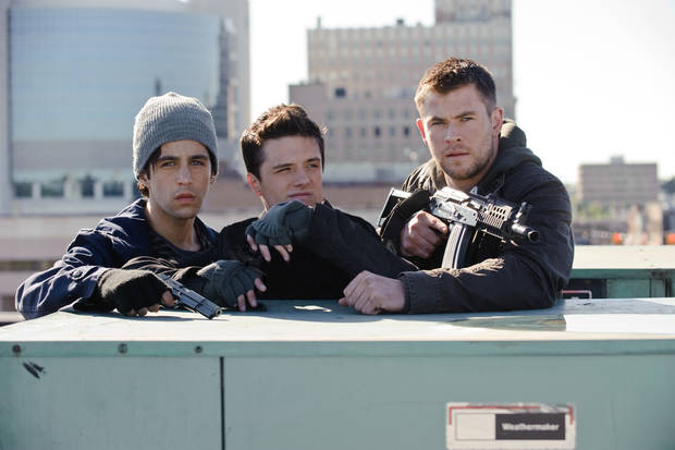 "This film image released by Film District shows Josh Peck , left, Josh Hutcherson, center, and Chris Hemsworth in a scene from ""Red Dawn."" (AP Photo/Film District)"