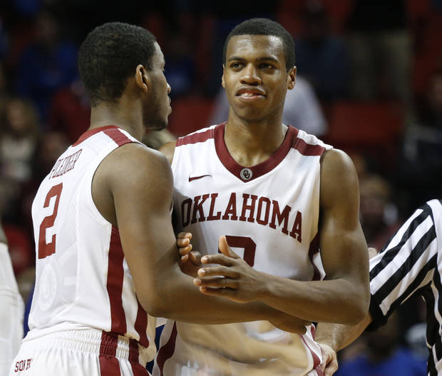 Oklahoma's Steven Pledger (2) congratulates Buddy Hield (3) after his free throws at the close of the second half as the University of Oklahoma Sooners (OU) defeat the Kansas Jayhawks (KU) 72-66 in NCAA, men's college basketball at The Lloyd Noble Center on Saturday, Feb. 9, 2013 in Norman, Okla. Photo by Steve Sisney, The Oklahoman