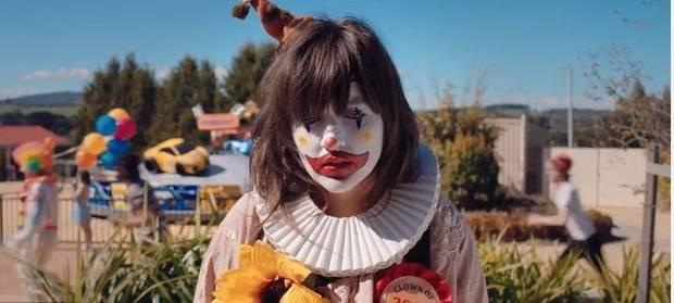 "Courtney Barnett appears as a sad-sack clown in the music video for ""Pedestrian at Best."""