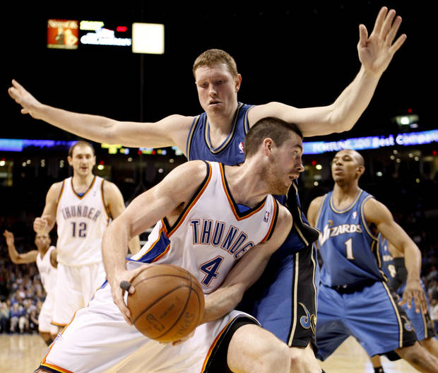 Oklahoma City's Nick Collison drives past Washington's Darius Songaila during the NBA basketball game between the Oklahoma City Thunder and the Washington Wizards at the Ford Center in Oklahoma City, Wed., March 4, 2009. PHOTO BY BRYAN TERRY, THE OKLAHOMAN