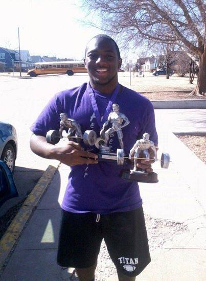 Carl Albert's Quincy Johnson with all his hardware from the powerlifting meet.