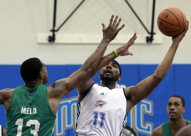 Oklahoma City Thunder's Lazar Hayward (11) shoots over Boston Celtic's Fab Melo (13) during an NBA summer league basketball game, Monday, July 9, 2012, in Orlando, Fla. (AP Photo/John Raoux) ORG XMIT: DOA108