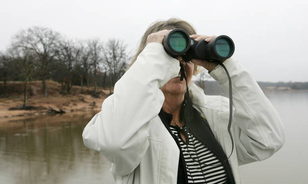 Robin Stead scans the sky for a glimpse of a bald eagle at Discovery Cove  Nature Center. OKLAHOMAN ARCHIVE PHOTO