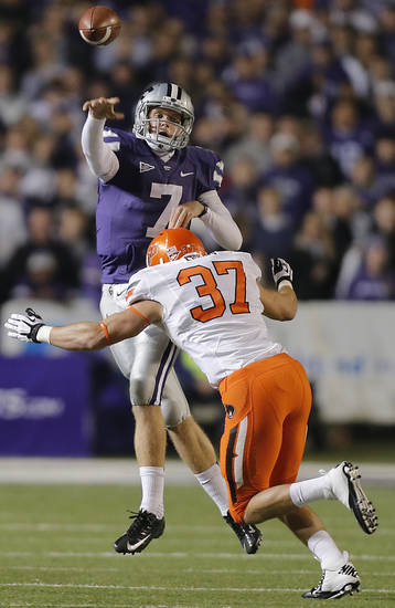 Oklahoma State's Alex Elkins (37) rushes Kansas State's Collin Klein (7) during the college football game between the Oklahoma State University Cowboys (OSU) and the Kansas State University Wildcats (KSU) at Bill Snyder Family Football Stadium on Saturday, Nov. 1, 2012, in Manhattan, Kan. Photo by Chris Landsberger, The Oklahoman