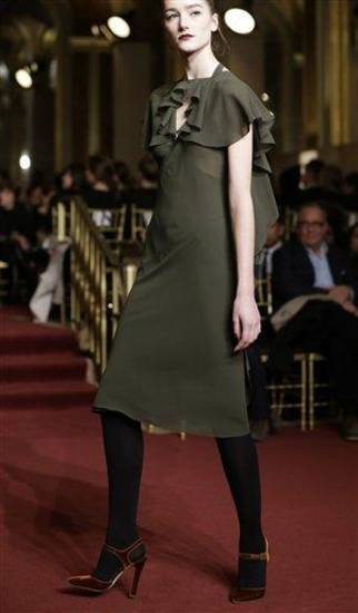 A model walks the runway during the Zac Posen Fall 2013 show at Fashion Week at the Plaza in New York, Sunday, Feb. 10, 2013.  (AP Photo/Kathy Willens)