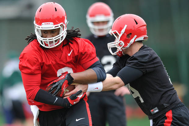 Georgia running back Todd Gurley (3), left, takes a handoff from Georgia quarterback Hutson Mason (14) during a Georgia spring football practice on Tuesday, March 18, 2014, in Athens, Ga. (AP Photo/Athens Banner-Herald, AJ Reynolds)