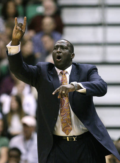 Utah Jazz Head Coach Tyrone Corbin shouts to his team in the second quarter during an preseason NBA basketball game with the Oklahoma City Thunder, Friday, Oct. 12, 2012, in Salt Lake City. (AP Photo/Rick Bowmer) ORG XMIT: UTRB109