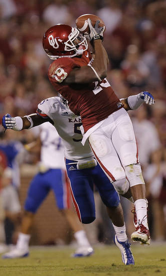 OU's Justin Brown (19) makes a catch in front of KU's Greg Brown (5) during the college football game between the University of Oklahoma Sooners (OU) and the University of Kansas Jayhawks (KU) at Gaylord Family-Oklahoma Memorial Stadium on Saturday, Oct. 20th, 2012, in Norman, Okla. Photo by Chris Landsberger, The Oklahoman