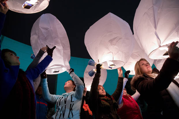 Attendees release paper lanterns during a vigil for victims of the Sandy Hook School shooting, Sunday, Dec. 16, 2012, in Omaha Neb. A gunman walked into the elementary school in Newtown, Conn., Friday and opened fire, killing 26 people, including 20 children. (AP Photo/The Omaha World-Herald, Rebecca S. Gratz) MAGS OUT; ALL NEBRASKA LOCAL BROADCAST, TV OUT.  ORG XMIT: NEOMA102