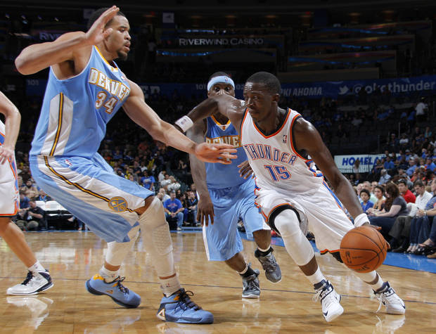 Oklahoma City's Reggie Jackson (15) drives the ball past Denver's JaVale McGee (34) during the NBA preseason basketball game between the Oklahoma City Thunder and the Denver Nuggets at the Chesapeake Energy Arena, Sunday, Oct. 21, 2012. Photo by Garett Fisbeck, The Oklahoman