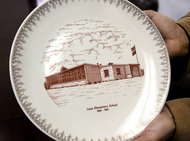 A 1961 commemorative plate features a drawing of Lane School. About 50 students transferred to Lane Public School after their former school, Farris School, was annexed by Lane in Atoka County.   Photo taken  March 1, 2013. Photo by Jim Beckel, The Oklahoman