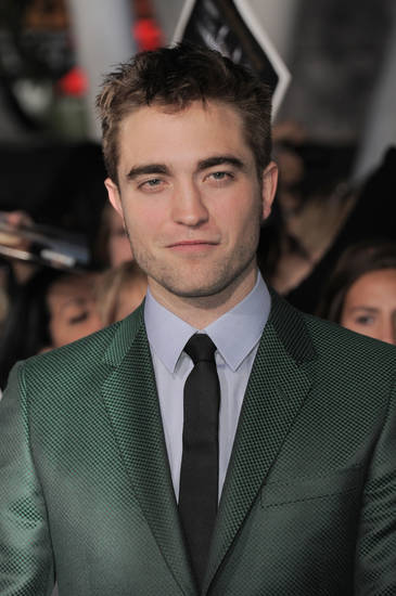 "Robert Pattinson attends the world premiere of ""The Twilight Saga: Breaking Dawn Part II"" at the Nokia Theatre on Monday, Nov. 12, 2012, in Los Angeles. (Photo by Jordan Strauss/Invision/AP) ORG XMIT: CAENT586"