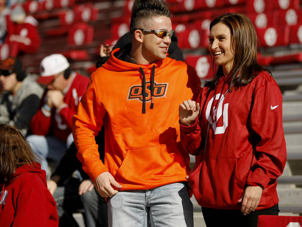 Oklahoma State fan Nick Fulk talks with Oklahoma fan Megan Luna before the Bedlam college football game between the University of Oklahoma Sooners (OU) and the Oklahoma State University Cowboys (OSU) at Gaylord Family-Oklahoma Memorial Stadium in Norman, Okla., Saturday, Nov. 24, 2012. Photo by Bryan Terry, The Oklahoman
