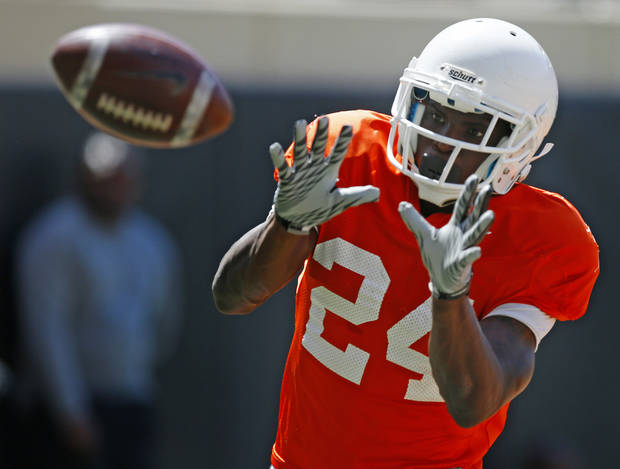 OSU's Tyreek Hill catches a pass during Oklahoma State's Orange Blitz football practice at Boone Pickens Stadium in Stillwater, Okla., Saturday, April 5, 2014.