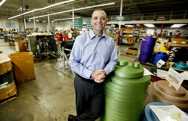 Beam's Seatbelts President Mike Bosley stands next to rolls of material used at his plant in Oklahoma City, Monday,  September  24, 2012. Photo By Steve Gooch, The Oklahoman