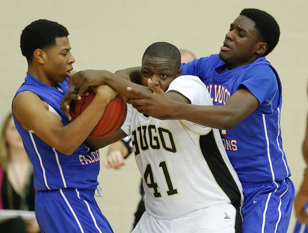 Milloowd's Michael Mays, left, and Jamal Green-Gaskins defend Hugo's C.J. Scott during a Class 3A boys state basketball tournament game between Hugo and Millwood at Yukon High School in Yukon, Okla., Thursday, March 7, 2013. Photo by Bryan Terry, The Oklahoman