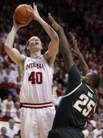 Indiana forward Cody Zeller, left, shoots over Michigan State center Derrick Nix in the second half of an NCAA college basketball game in Bloomington, Ind., Tuesday, Feb. 28, 2012. Indiana defeated Michigan State 70-55. (AP Photo/Michael Conroy)