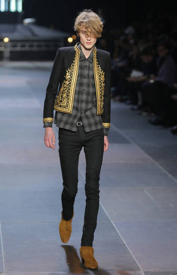 A model wears a creation by Born French fashion designer Hedi Slimane for St Laurent as part of the Men's fall-winter 2013-2014 fashion collection presented in Paris, Sunday, Jan. 20, 2013. (AP Photo/ Jacques Brinon)