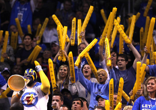 Fans cheer during the season opener NBA basketball game between the Oklahoma City Thunder and the Chicago Bulls in the Oklahoma City Arena on Wednesday, Oct. 27, 2010. Photo by Sarah Phipps, The Oklahoman