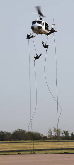Oklahoma Bureau of Narcotics and Dangerous Drugs agents rappel from a helicopter to show off pot-fighting techniques on Wednesday, August 24, 2011, in Norman, Okla.   Photo by Steve Sisney, The Oklahoman