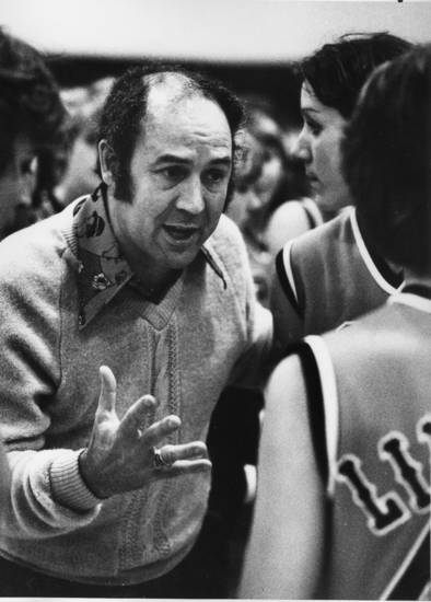 "Lindsay coach Charles Heatly, above, talks things over with his players during a break in the action.""  Staff Photo by Doug Hoke 1-4-80. Ran in the Daily Oklahoman 1-5-80"