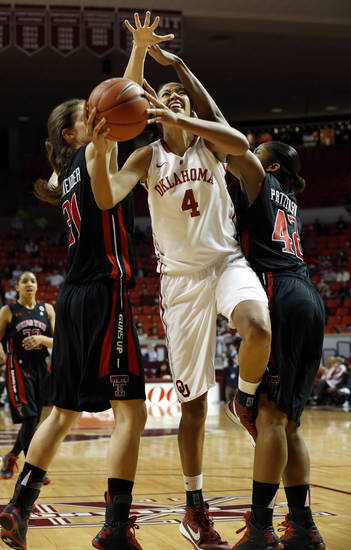 Oklahoma Sooner's Nicole Griffin (4) cuts betweenTech's Haley Schneider (31) and Jackie Patterson (42) as the University of Oklahoma Sooners (OU) play the Texas Tech Lady Red Raiders in NCAA, women's college basketball at The Lloyd Noble Center on Saturday, Jan. 12, 2013 in Norman, Okla. Photo by Steve Sisney, The Oklahoman