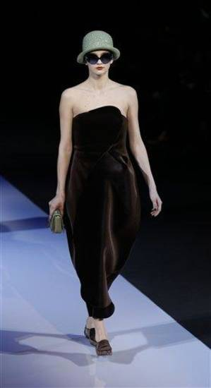 A model wears a creation for Emporio Armani women's Fall-Winter 2013-14 collection, part of the Milan Fashion Week, unveiled in Milan, Italy, Sunday, Feb. 24, 2013. (AP Photo/Luca Bruno)