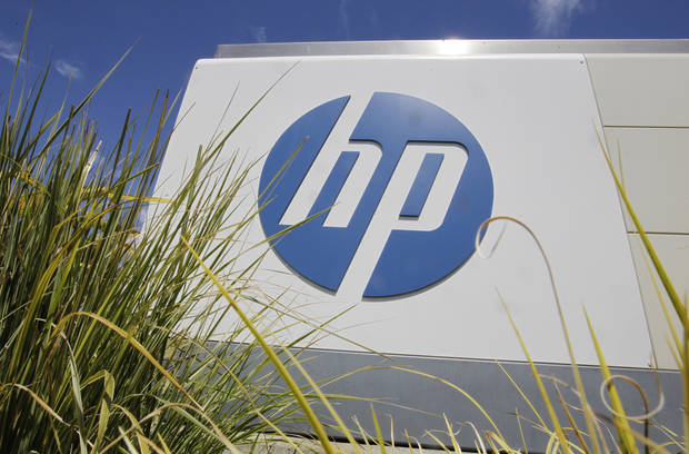In this Aug. 21, 2012 photo, the Hewlett-Packard Co. logo is seen outside the company's headquarters in Palo Alto, Calif. HP said Autonomy Corporation PLC, a British company it bought for $10 billion last year, lied about its finances, resulting in a massive write-down of the value of the business. HP�s net loss for the fiscal fourth quarter, which ended Oct. 31, amounted to $6.85 billion, or $3.49 per share. (AP Photo/Paul Sakuma)
