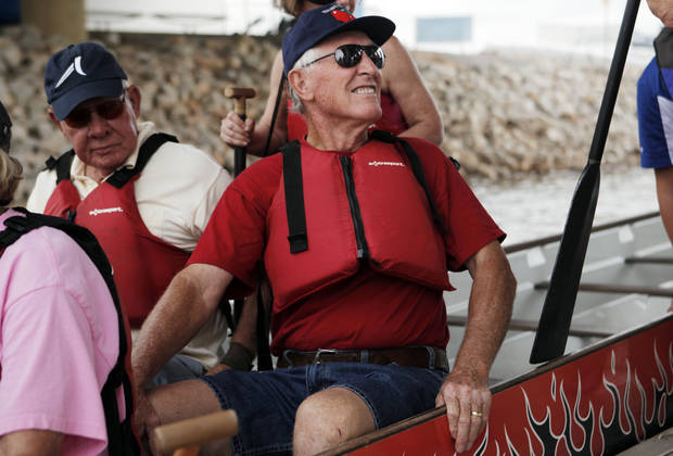 John Imel, 74, sits on a dragon boat on the Oklahoma River as his group from the Bethany YMCA waits to go out for a test run and workout on June 19, 2013. Photo by KT KING, The Oklahoman