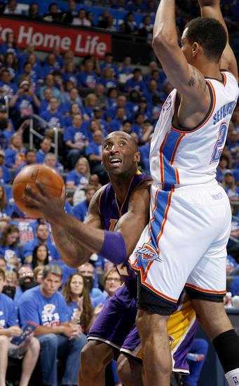 Los Angeles' Kobe Bryant (24) looks to shoot as Oklahoma City's Thabo Sefolosha (2) defends during Game 5 in the second round of the NBA playoffs between the Oklahoma City Thunder and the L.A. Lakers at Chesapeake Energy Arena in Oklahoma City, Monday, May 21, 2012. Photo by Bryan Terry, The Oklahoman