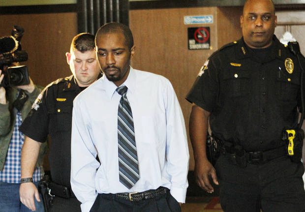 Christopher Travis Baker is taken Thursday from the courtroom at the Oklahoma County Courthouse in Oklahoma City. Photo By Steve Gooch, The Oklahoman