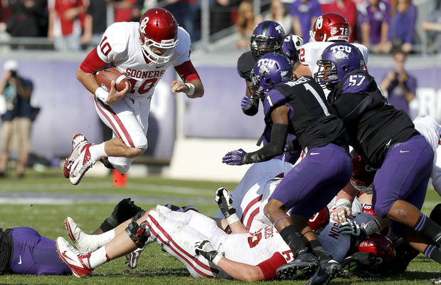 Oklahoma's Blake Bell (10) leaps for a first during a college football game between the University of Oklahoma Sooners (OU) and the Texas Christian University Horned Frogs (TCU) at Amon G. Carter Stadium in Fort Worth, Texas, Saturday, Dec. 1, 2012. Oklahoma won 24-17. Photo by Bryan Terry, The Oklahoman